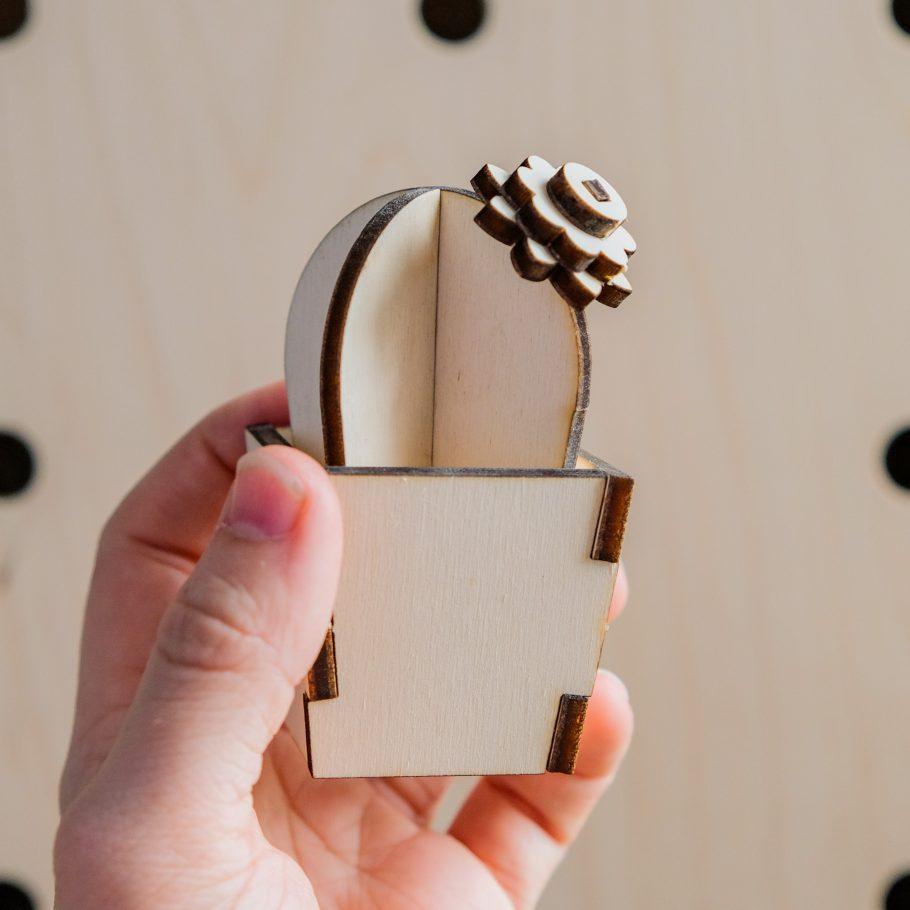 Hand holding wooden Barrel Cactus Ornament